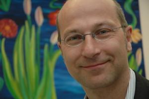 Dr. Robert Lange lächelt